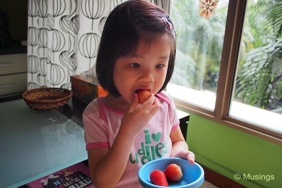 Munching on strawberries.