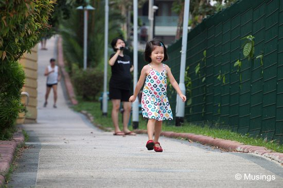 On every occasion we've shot from the stretch of pavement that's between the site and HDB blocks, Hannah enjoys running up and down the stretch.
