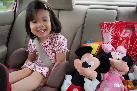 Just check out how happy she was on our way home. She spent the ride home adjusting (and readjusting) the two toys beside her.=)