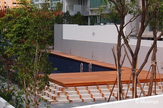 Wooden decks have been installed at the heated pool.