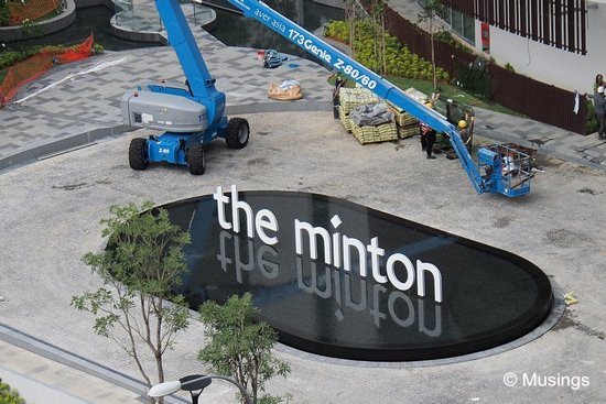 The front signage's water feature is complete - nice! Check out the almost perfect reflection of the condo's name.