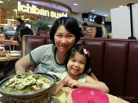 The two girls over dinner at Lenas @ Hougang Mall, our Friday dinner hangout. That item in the foreground is Sauteed mushrooms in egg sauce, alongside arlic rice, salad and soup as sides.