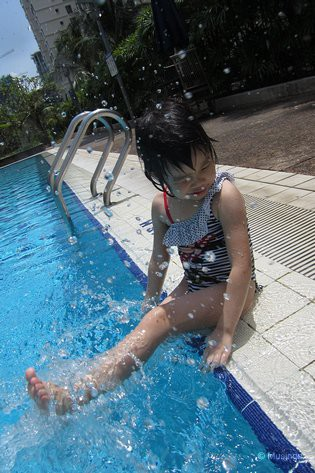 At the pool, and perfect for a swim on a hot and scorching noon-time Sunday. Just 30 minutes though and she got a tan. She needs to get into the sun a lot more.