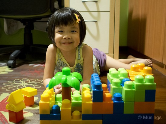 Hannah asked for a picture to be taken of her latest home-building project using megablocks. Taken at 17mm f1.8.