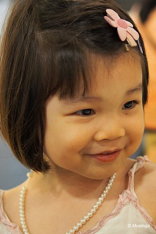 3 Years 9 Months old in March 2013, and wearing her faux pearl necklace given to her by her maternal grandmom. That necklace has gone through a lot of abuse though, and finally broke apart irreparably earlier this month.