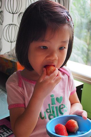 3 Years 10 Months in April 2013, and munching on strawberries. Like Mommy, she loves fruits that Daddy doesn't enjoy (that includes tomatoes, grapes, kiwi and strawberries!