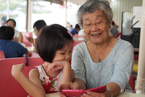 Mom has discovered taking grandchildren photos on her handphone, and sharing the joy of her empowerment with Hannah.