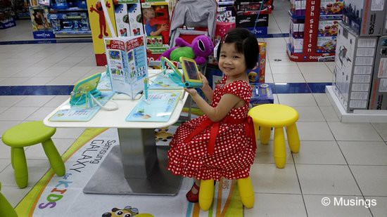 Hannah has quite taken to the child-oriented Samsung Galaxy Tab 3 for kids; this was at Toys R' Us at Tampines Mall on Tuesday. I'm a little tempted to get this for her - it's really loaded up the gills with child-friendly applications, several of which are quite educational.