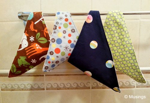 4 different fabrics used for Peter's 15 bibs.