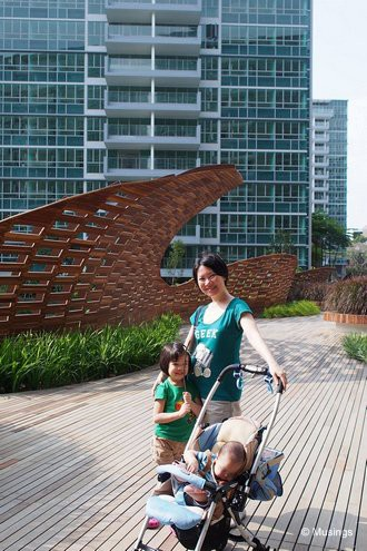 At the contemporary bridge. Peter is more interested in the bridge's wood decking.=)