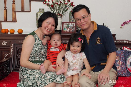 Our yearly CNY picture. Peter is still struggling to break free.