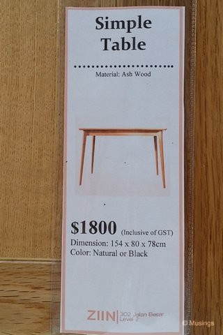 The descriptor and price tag of the table.