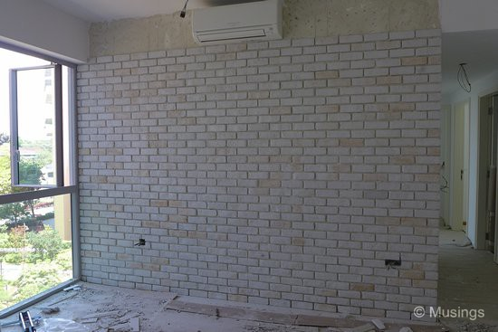 Ling's vanity request - a craft brick wall for the dining hall. Cost me a bomb, but it made her happy.:)