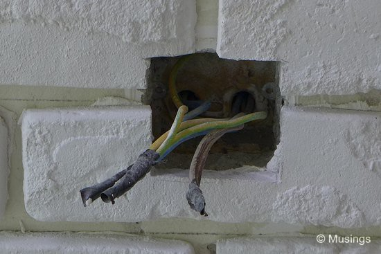 As its fashionable in today's brick walls; the power socket from the earlier wall had been relocated, and will be installed on top of the craft bricks.