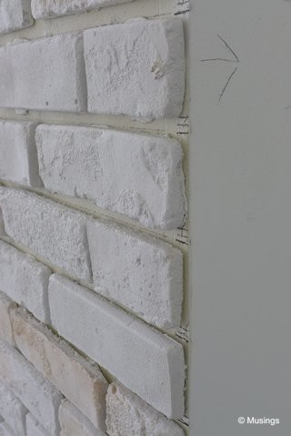 My sister-in-law had a similar brickwall in her home, and she remarked that it could be quite painful if someone carelessly bumps into the wall edge. We'll be getting our designer to smooth over the sharp edges here.