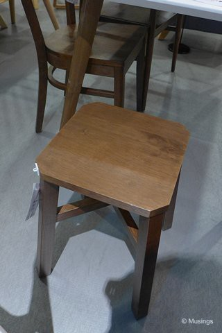 'Tang' wooden stool in cocoa finish. We bought two of these and will be additional seating if we have more than four persons at the table.