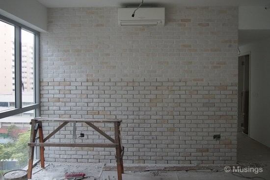 Half-done work LOL. Half of the craftbrick wall has been properly plastered over, but the second half has not been completed yet.