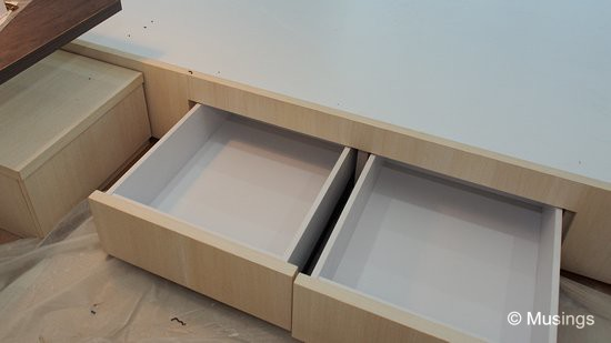 Four drawers built into the bedframe base.