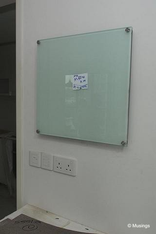 "Our glass writing board. Our designer found a contact point to do a small one for us. This will be our space for us to scribble ""Menu for the day"", and ""Household Chores Roster"".:)"