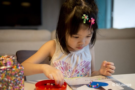 Another one of those 'in' activities now for kids. Ling bought her a large jar of Pyssla beads from Ikea. She's put together simple patterns and have been proudly presenting them to everyone around her.