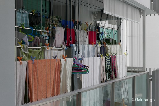 Two stacks of four tiered clotheslines - not counting the
