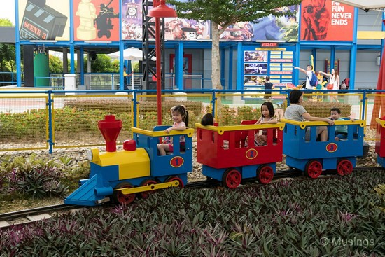 Miniature train ride. This one runs on a small circuit sitting inside a large tent.
