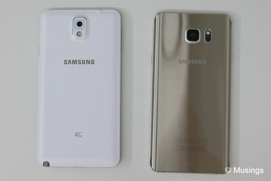 Very different backs. One is premium-looking but a real fingerprint magnet!