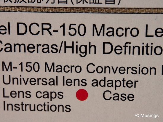 With the DCR150 mounted onto the 12-50mm. The lens' front element was perhaps just about 1-2cm away from the box!
