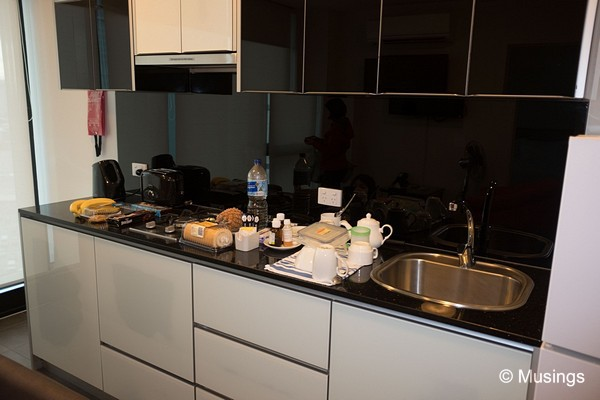 Our suite's kitchen on a typical afternoon. Fruits from QVM and other snack items from Woolsworth.